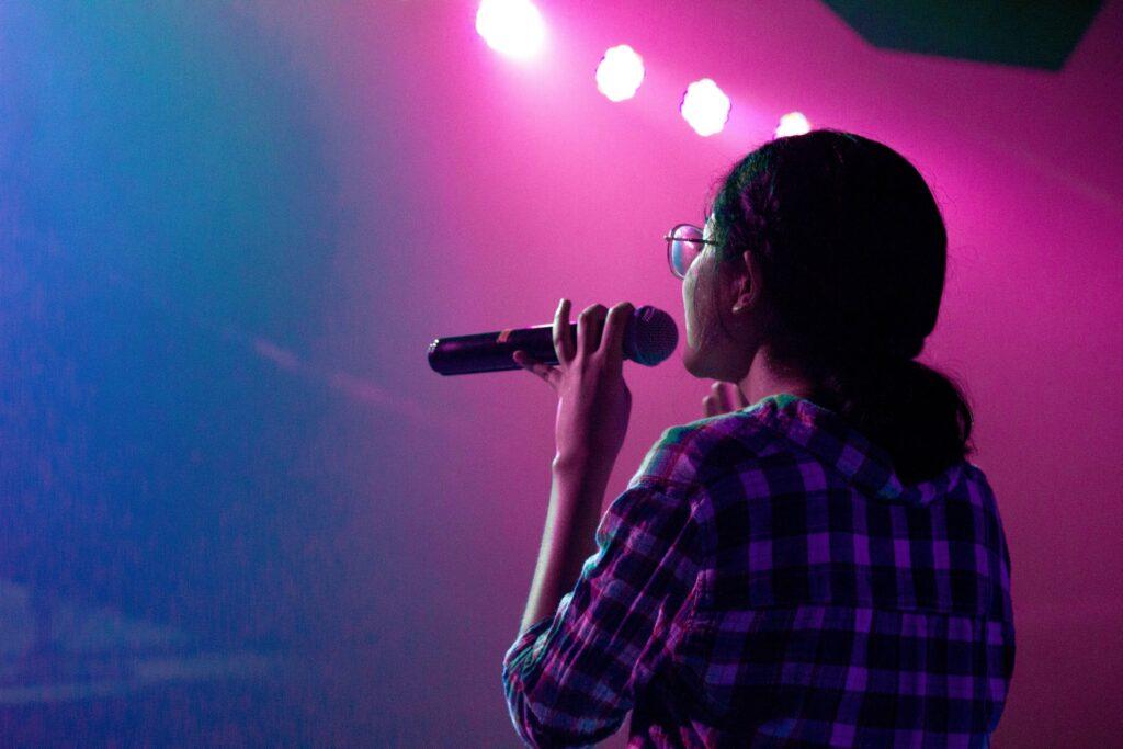 woman holding mic