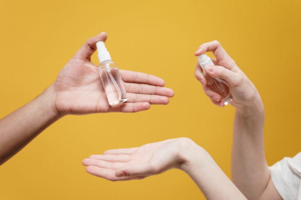 people holding spray
