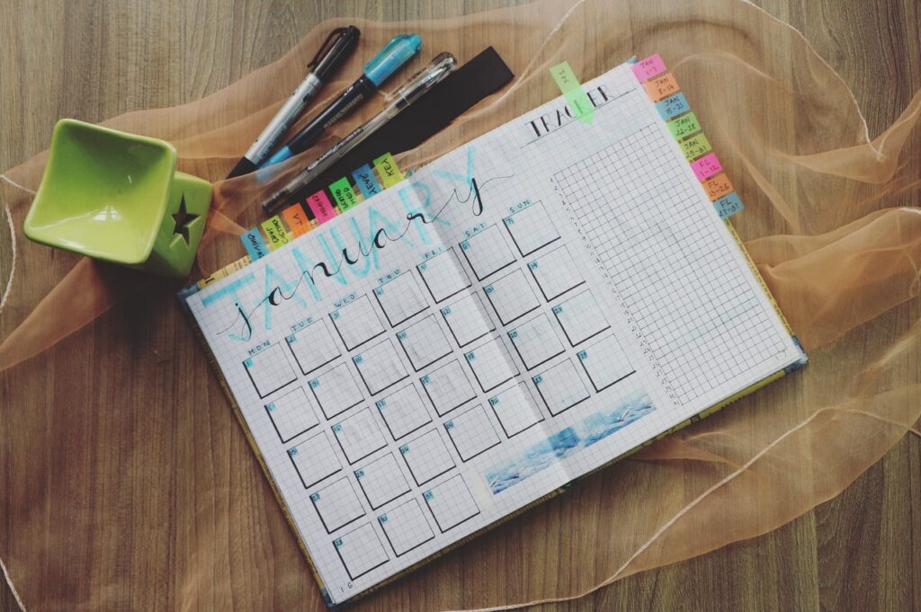 photo-of-planner-and-writing-materials