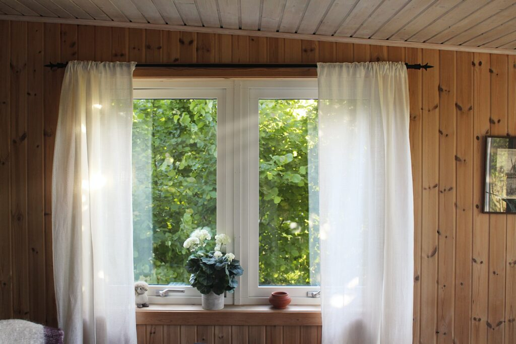 window with plain white curtain