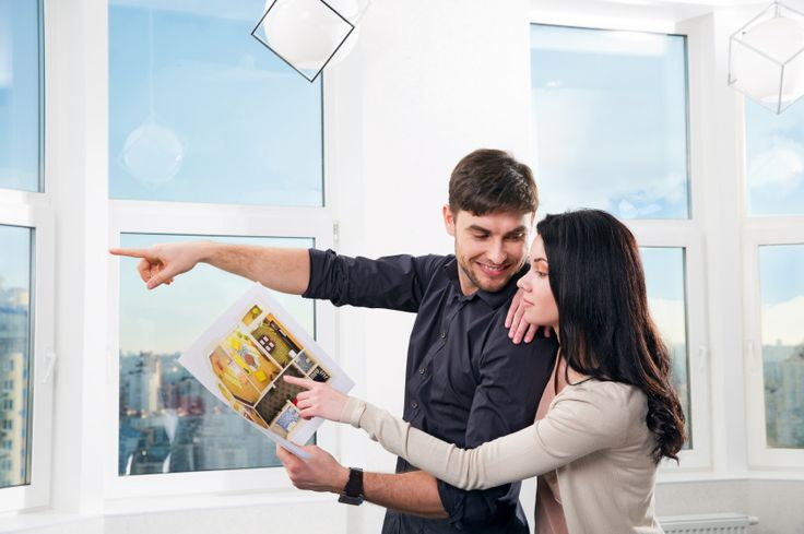 young couple, searching the real estate for a purchase