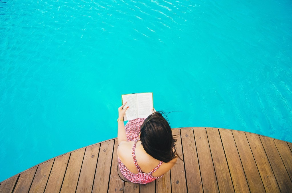girl reading books in pool