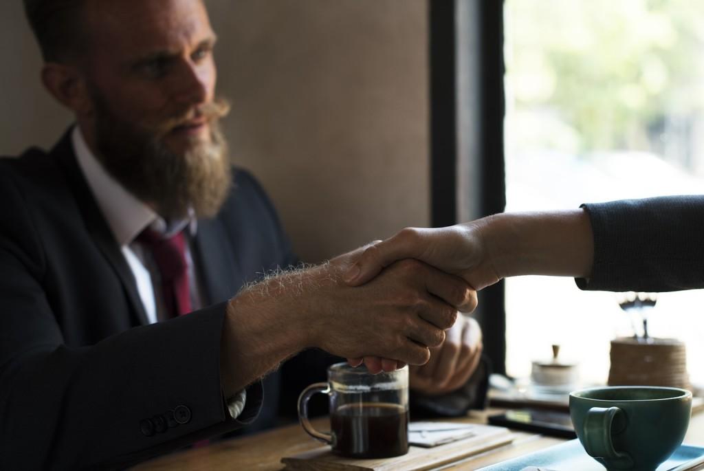 handshake deal with professionals