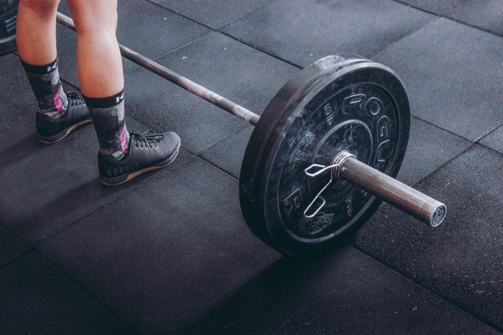 man barbell gym