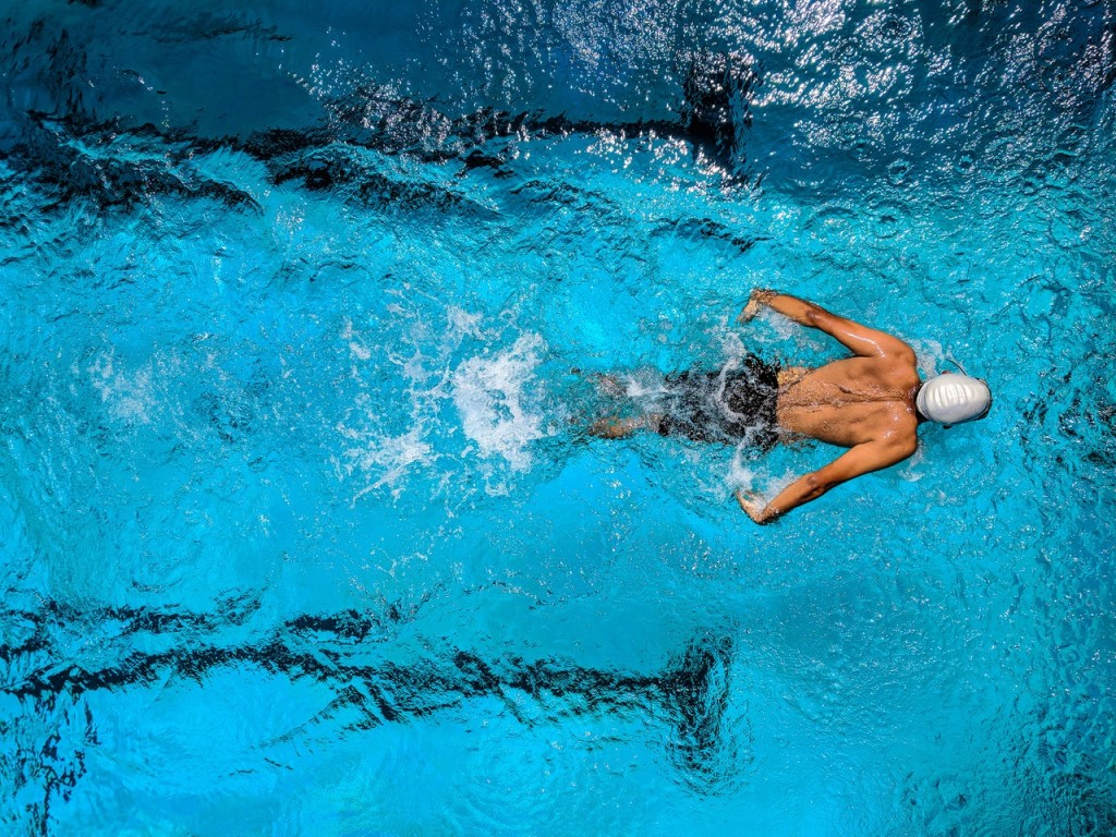 man swimming butterfly